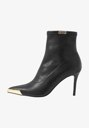 High heeled ankle boots - nero