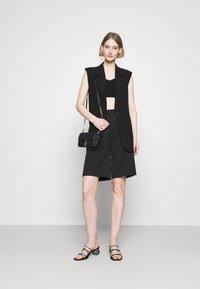 Bruuns Bazaar - LUCILLE LOEWE - Waistcoat - black - 1