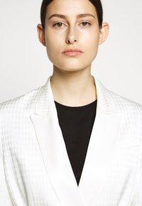 KARL LAGERFELD - CAMEO BELT - Short coat - off white - 4