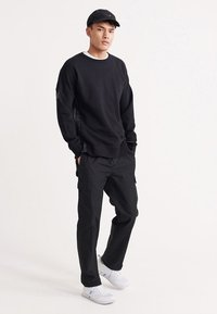 Superdry - UPERDRY NYCO PANTS - Cargo trousers - black - 1