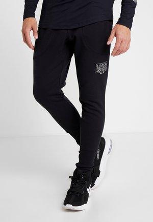 BASELINE JOGGER - Tracksuit bottoms - black/ash gray