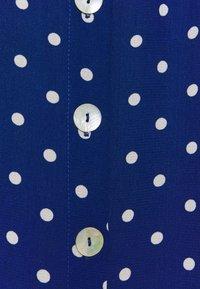King Louie - JUNO BUTTON SKIRT PABLO - A-line skirt - midnight - 2