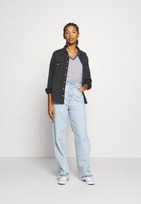 Levi's® - HIGH LOOSE - Flared jeans - light indigo - flat finish - 1