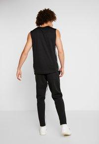 adidas Performance - Verryttelyhousut - black/white - 2