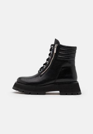 KATE LUG SOLE DOUBLE ZIP BOOT - Platform ankle boots - black