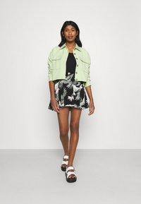Vero Moda - VMSIMPLY EASY SHORT SKATER SKIRT - Mini skirt - black - 1