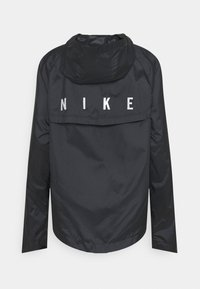 Nike Performance - RUN JACKET - Sports jacket - black/silver - 1