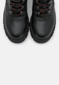 Buffalo - Platform ankle boots - black - 5