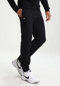 Lacoste Sport - Spodnie treningowe - black - 0