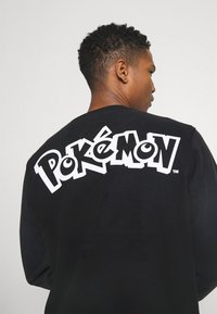 Levi's® - LEVI'S® X  POKÉMON UNISEX CREW - Sweatshirt - yellows/oranges - 4