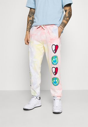 THE WORLD UNISEX - Tracksuit bottoms - tie dye
