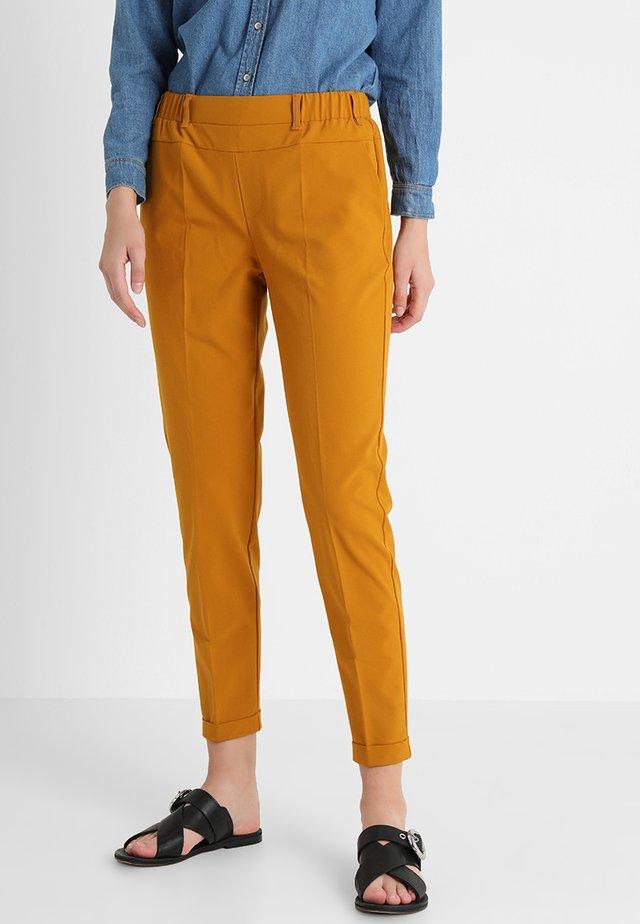 NANCI JILLIAN - Trousers - buckthorn