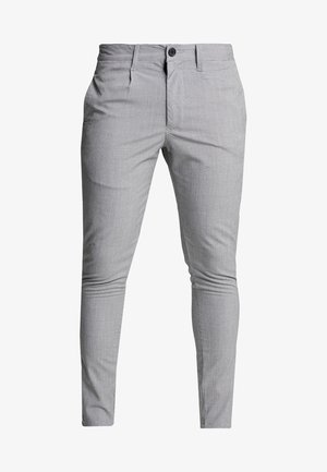 STERLING - Trousers - black/white