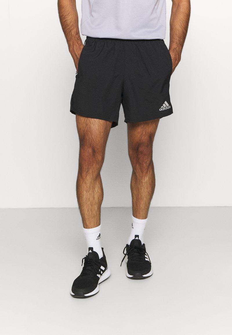 adidas Performance - OWN THE RESPONSE AEROREADY - Korte sportsbukser - black