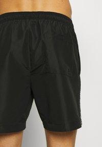 Calvin Klein Swimwear - MEDIUM DRAWSTRING - Swimming shorts - black - 1