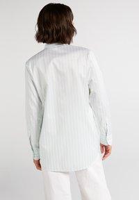 Eterna - Button-down blouse - pastellgrün/weiß - 1