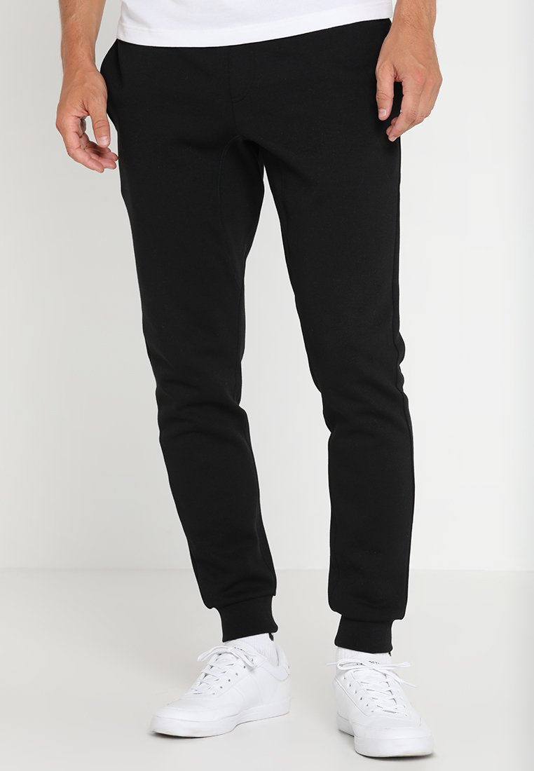 Lacoste Sport - Tracksuit bottoms - black