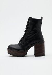 Jonak - KALI - Platform ankle boots - noir - 1