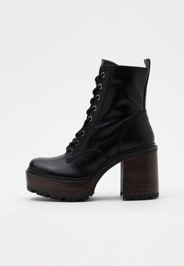 KALI - Platform ankle boots - noir