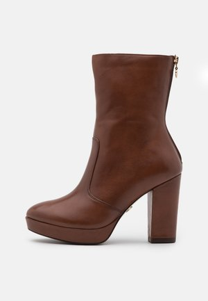 BOOTS  - High heeled ankle boots - brandy