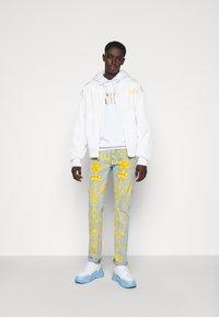 Versace Jeans Couture - HARRY - Slim fit jeans - light-blue denim - 1