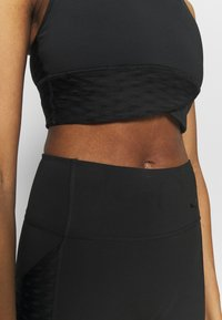 Puma - MID IMPACT FLAWLESS BRA - Medium support sports bra - black - 3