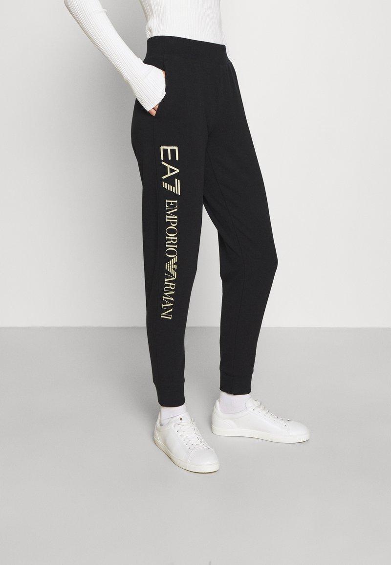 EA7 Emporio Armani - Pantalones deportivos - black/light gold