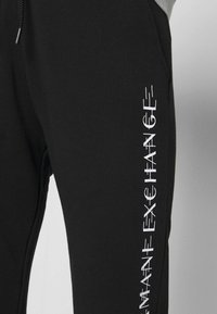 Armani Exchange - TROUSER - Trainingsbroek - black - 4