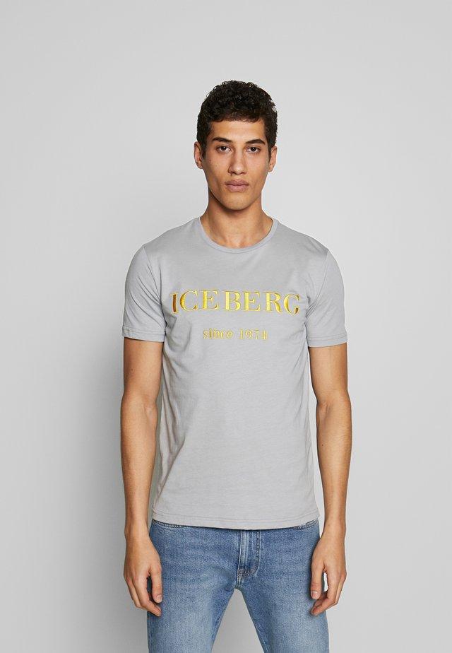 T-shirt med print - grigio