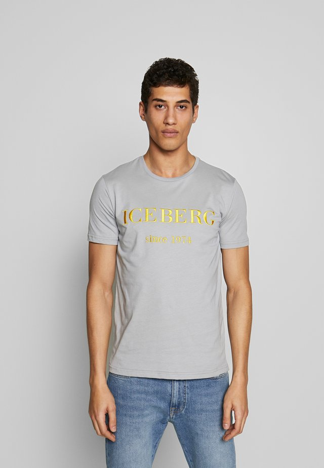 T-shirts med print - grigio