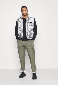 Nike Sportswear - Tracksuit bottoms - twilight marsh/white - 1