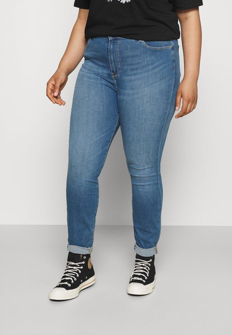 Tommy Hilfiger Curve - FLEX HARLEM - Slim fit jeans - izzy