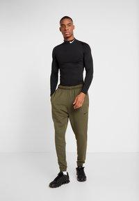 Nike Performance - DRY PANT TAPER - Tracksuit bottoms - cargo khaki/black - 1