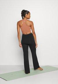 Curare Yogawear - PANTS SKIRT - Teplákové kalhoty - black - 2