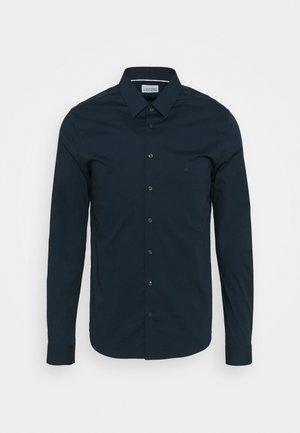LOGO STRETCH EXTRA SLIM - Camicia elegante - blue