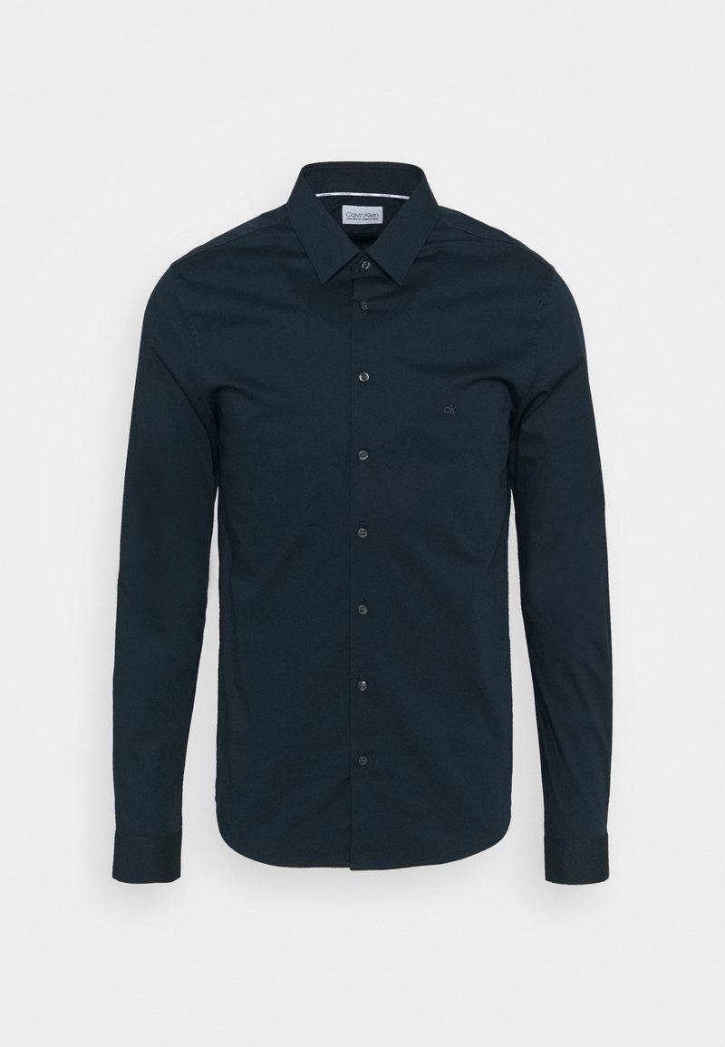 Calvin Klein Tailored - LOGO STRETCH EXTRA SLIM - Formal shirt - blue