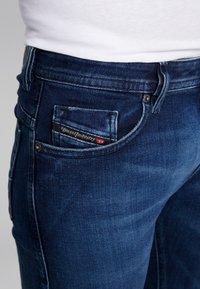 Diesel - THOMMER-X - Slim fit jeans - 0095T01 - 5