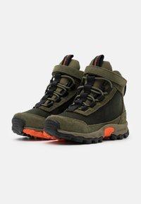 Columbia - CHILDRENS FLOWBOROUGH MID - Hiking shoes - nori/tangy orange - 1