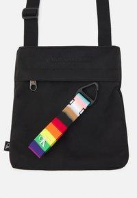 Calvin Klein Jeans - PRIDE MICRO FLAT PACK UNISEX - Across body bag - black - 3