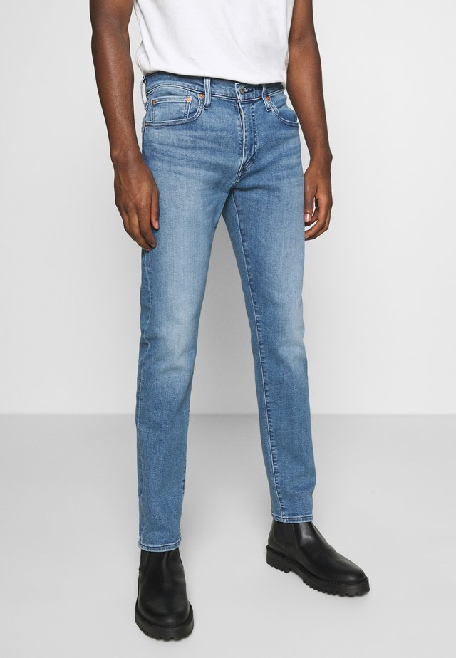 512™ SLIM TAPER - Jeans Tapered Fit - med indigo