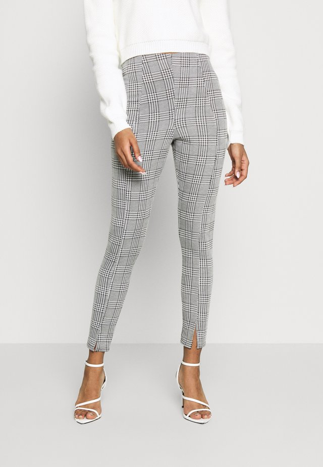 HOUNDSTOOTH SPLIT FRONT LEGGING - Leggings - Trousers - black