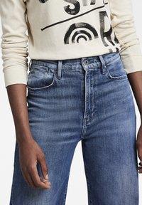 G-Star - DECK ULTRA HIGH WIDE LEG - Flared Jeans - faded santorini - 3