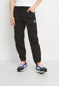 Puma - CLASSICS   - Cargo trousers - black - 0
