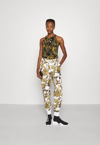 Versace Jeans Couture - PANTS - Tracksuit bottoms - white/gold - 1