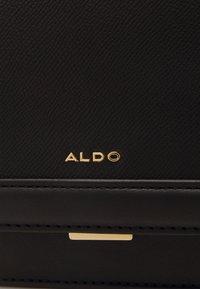 ALDO - YAEWIA - Handbag - black/gold - 4