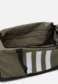 adidas Performance - ESSENTIALS 3 STRIPES SPORTS DUFFEL BAG UNISEX - Sports bag - legend green/black/white - 3