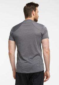 Haglöfs - L.I.M STRIVE TEE - Print T-shirt - magnetite - 1