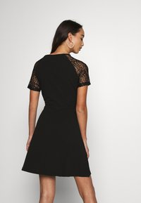 Vero Moda - VMJASMINE LACE TIE SHORT DRESS - Jersey dress - black