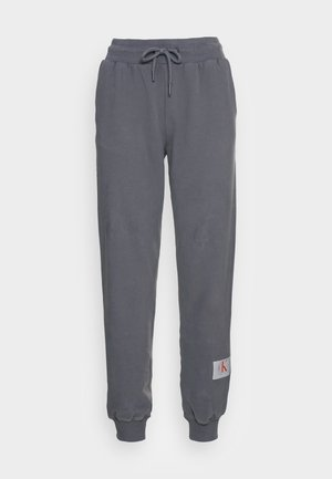 RELAXED FIT TRACK PANT - Tracksuit bottoms - shining armor