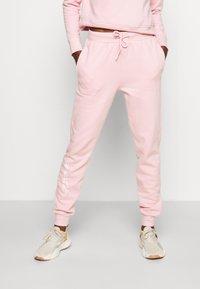 Guess - ALEXANDRA LONG PANT - Tracksuit bottoms - taffy light pink - 0